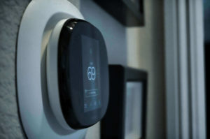 Ecobee thermostat on wall