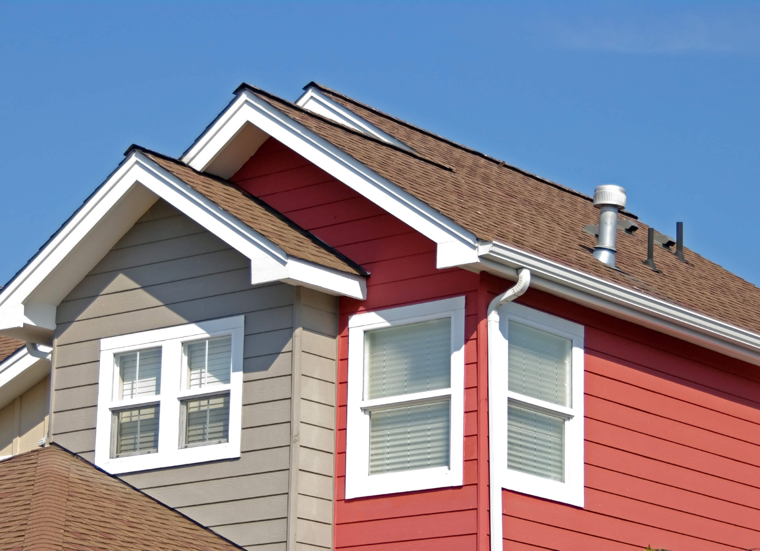 Eaves of red and beige house
