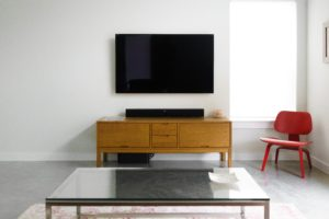 flatscreen TV mounted on wall
