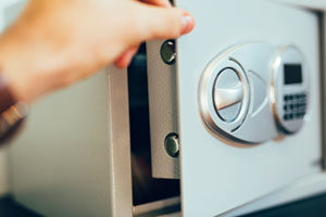 woman opening safe