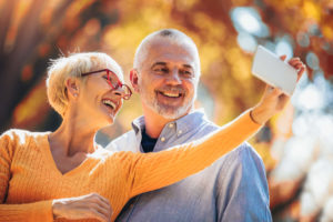 Older couple taking a selfie