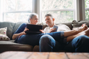Couple on couch using the internet