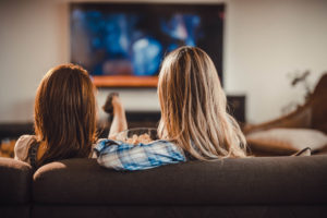 Two women watching Netflix on TV