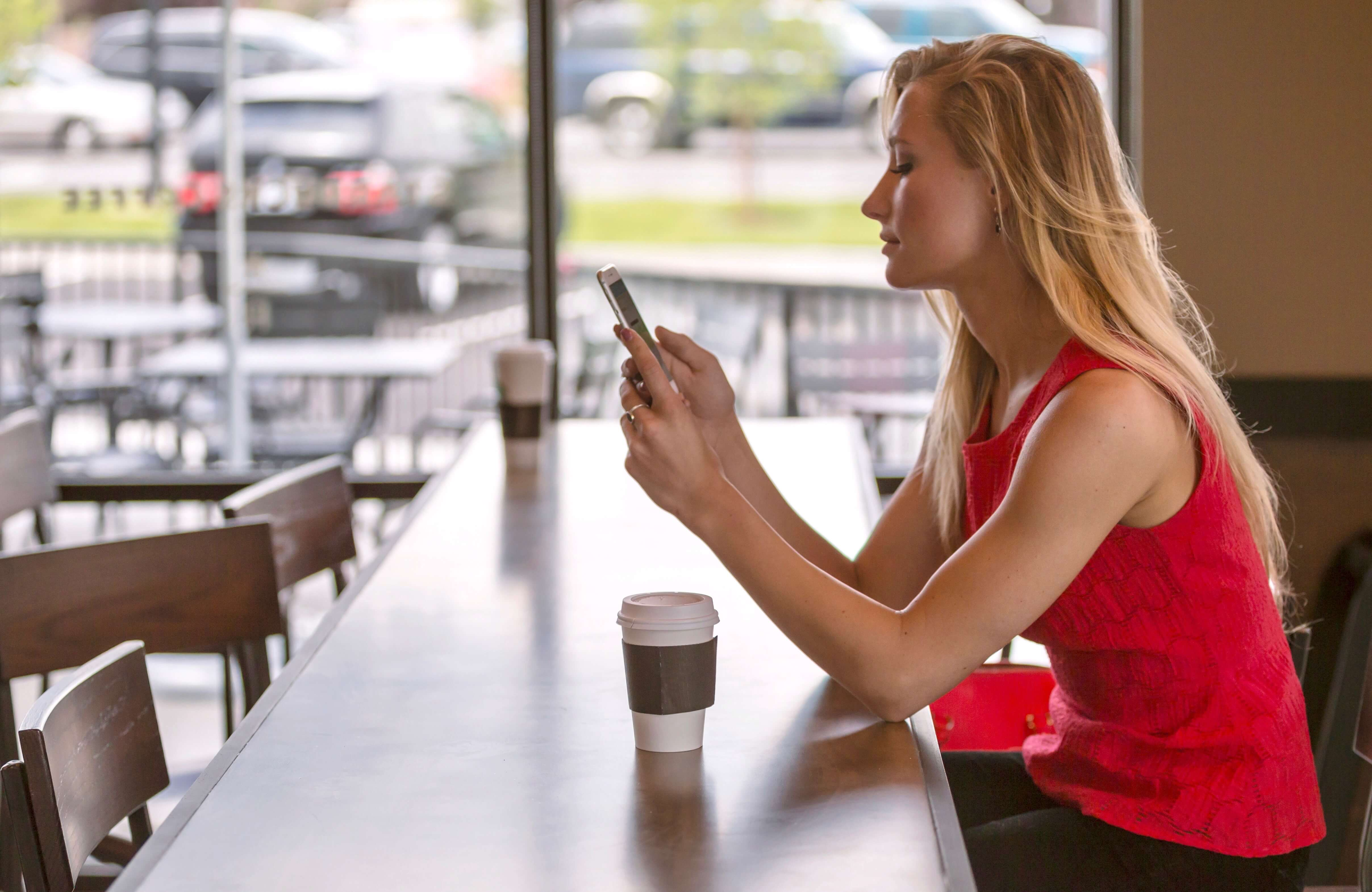 woman researching slow internet on phone
