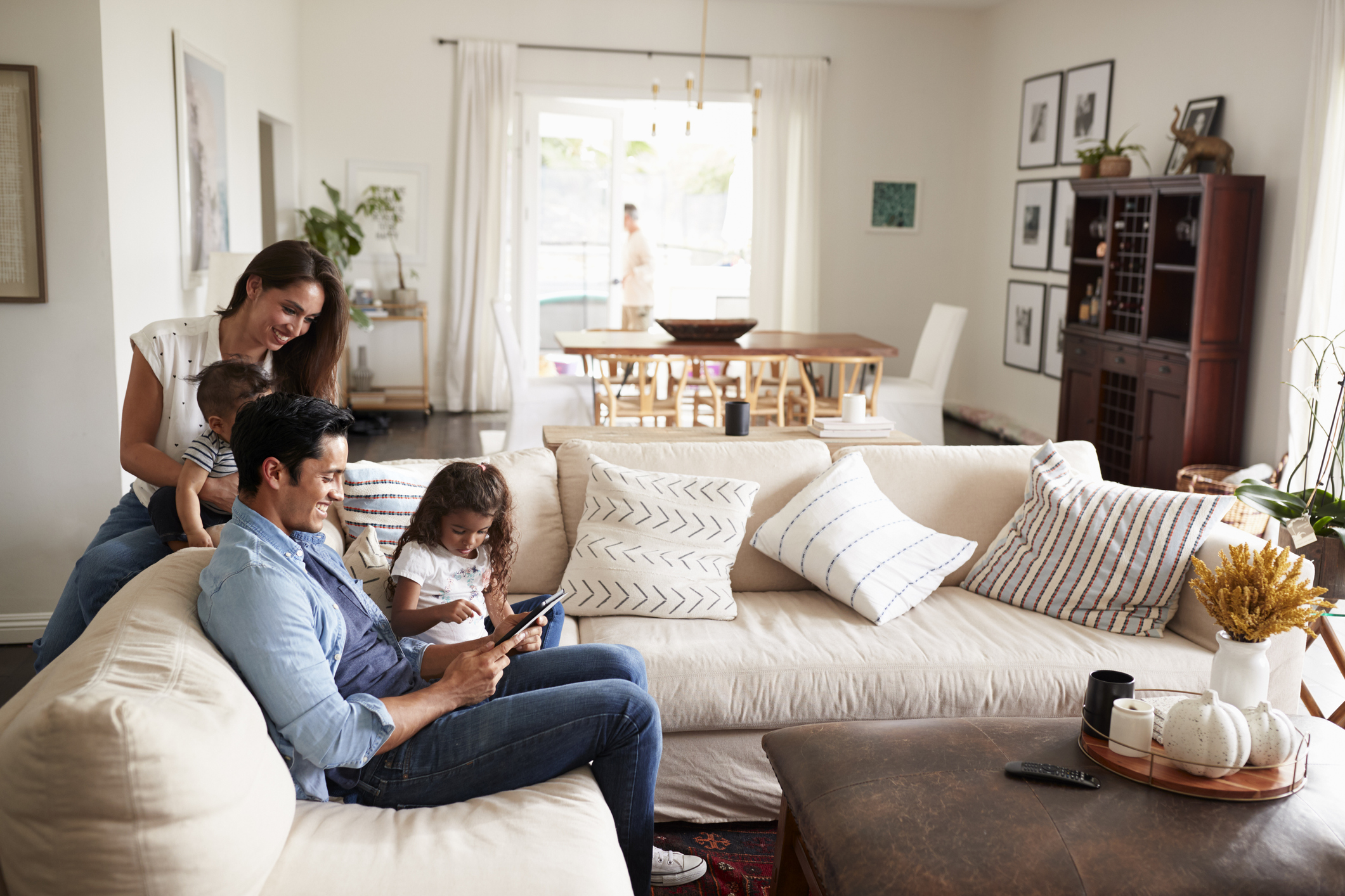 Young family using Cox internet in their living room
