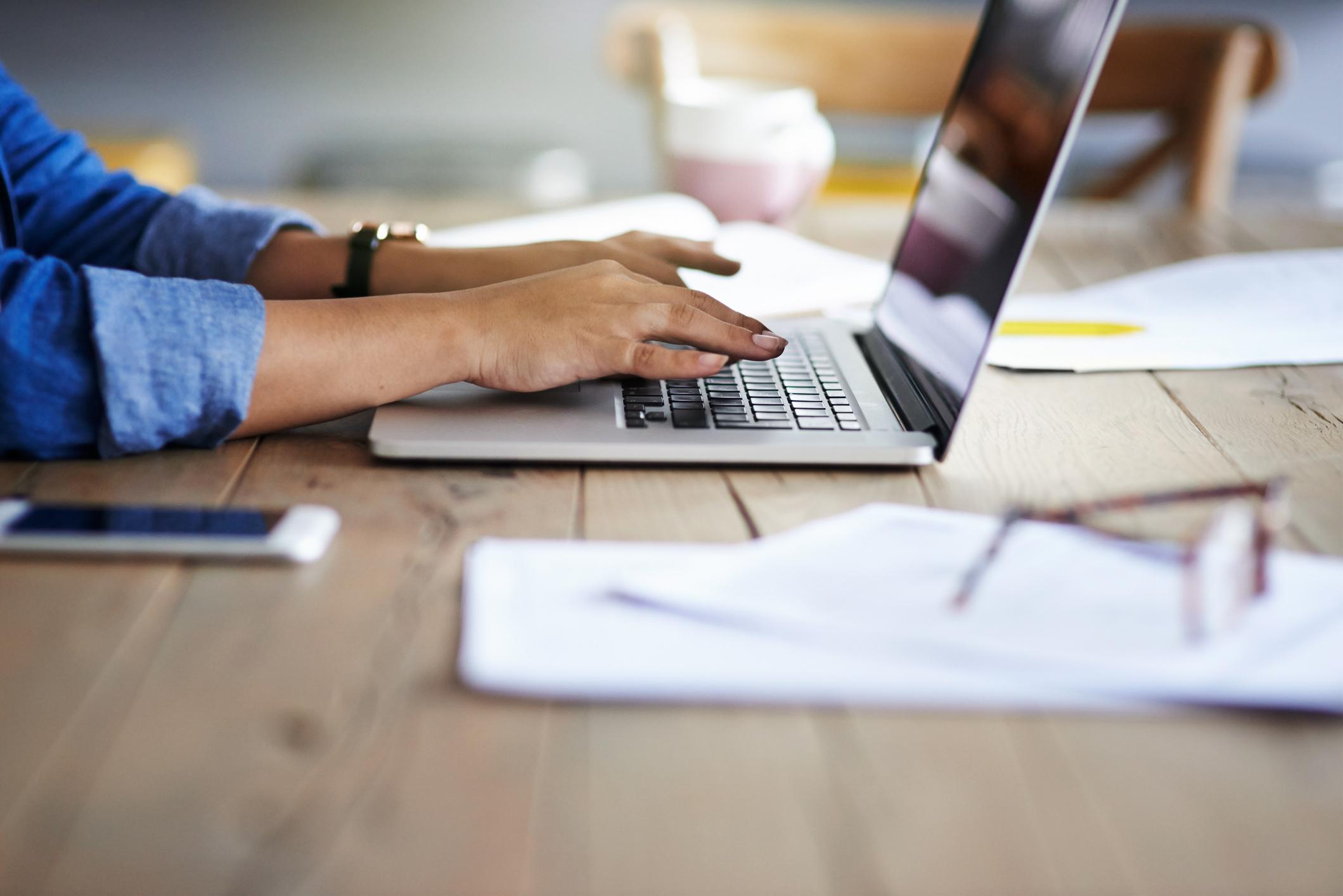 Hands on laptop using fiber internet