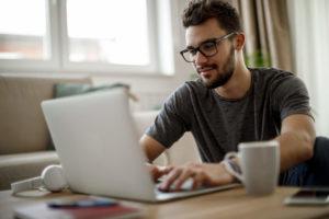 man working on laptop using Xfinity