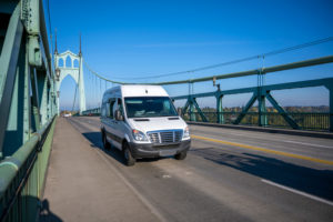 Cargo van driving on bridge