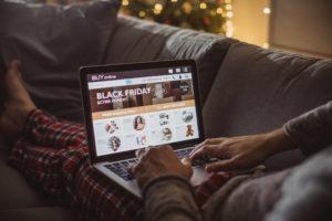 Man on laptop black friday shopping online