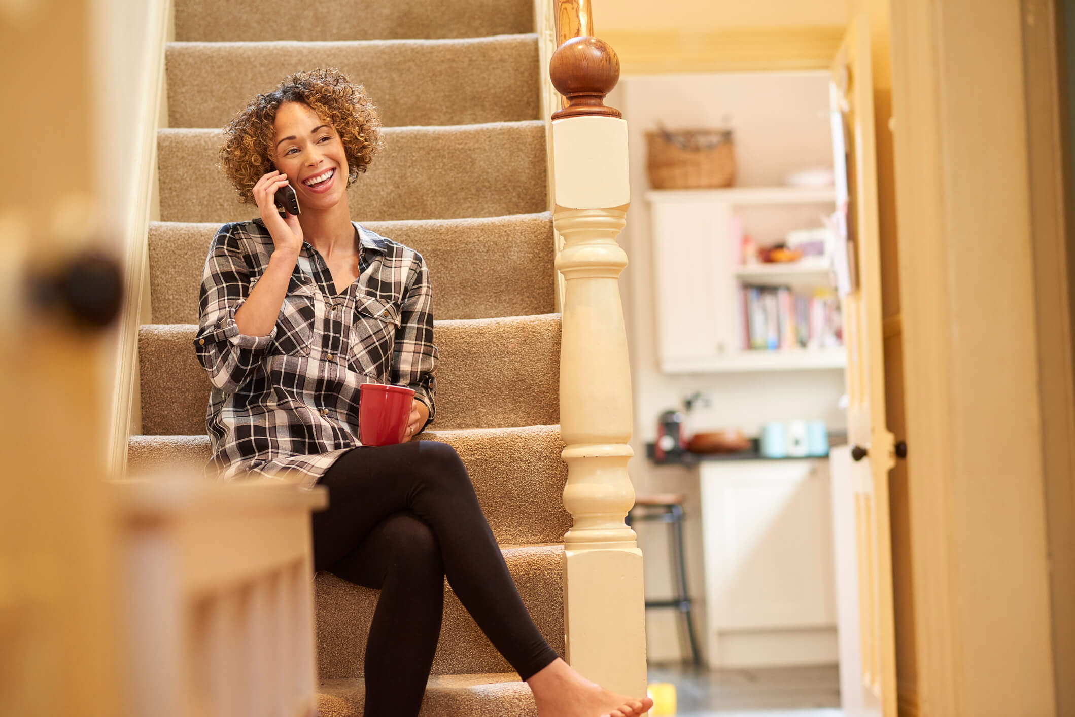 A woman talking on her home phone