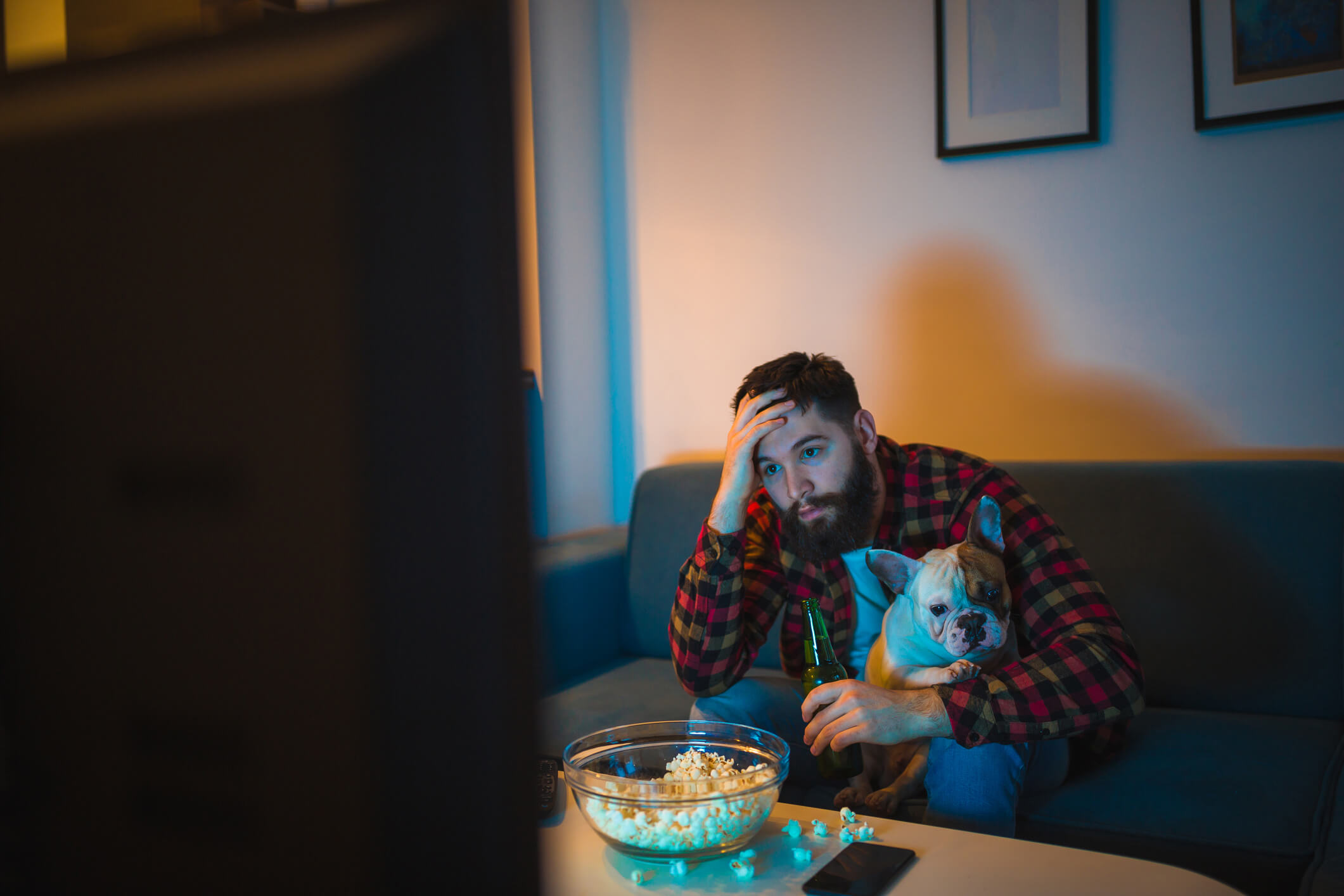 Man trying to watch Disney Plus with his dog