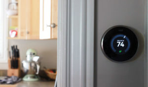 Nest Learning Thermostat on wall in home