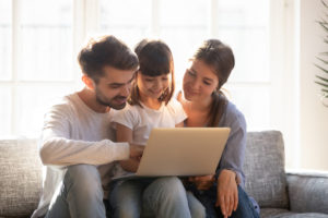 Happy family spending time at home browsing the internet