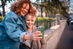 Two people taking a selfie together in a park