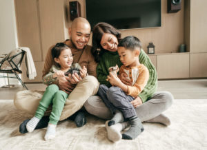 Parents with two children in living room
