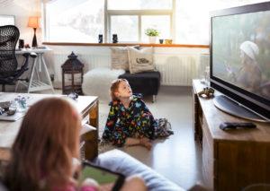 Boy sitting on floor watching Sparklight TV