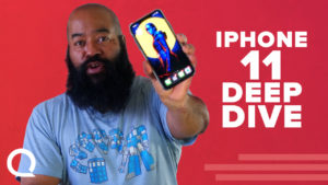 Tshaka Armstrong holding an iphone 11 for a video review