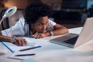 Frustrated woman using the internet