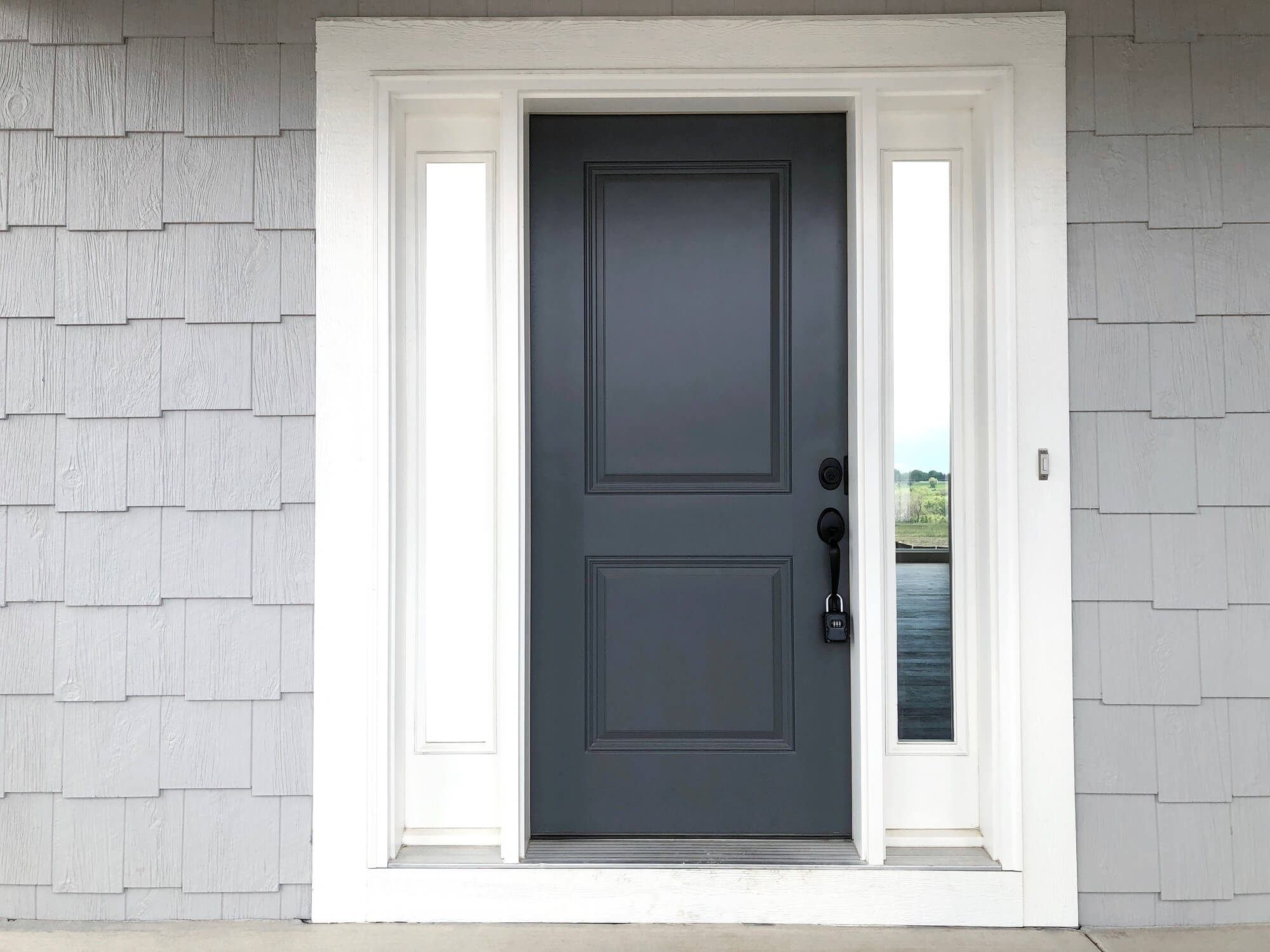 dark gray front door on light gray house