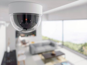 Dome security camera on the ceiling of a living room