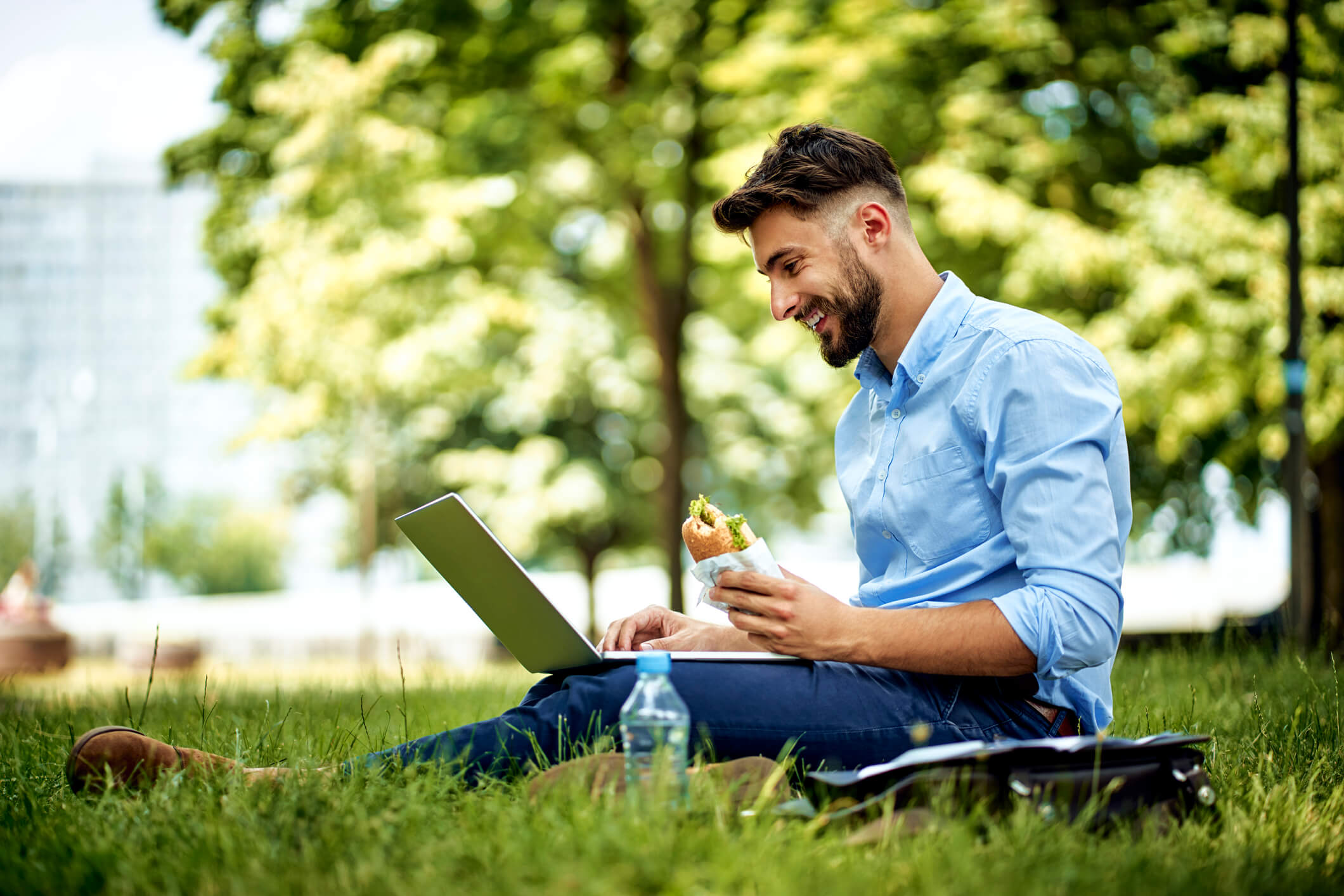 Man working outside on his laptop