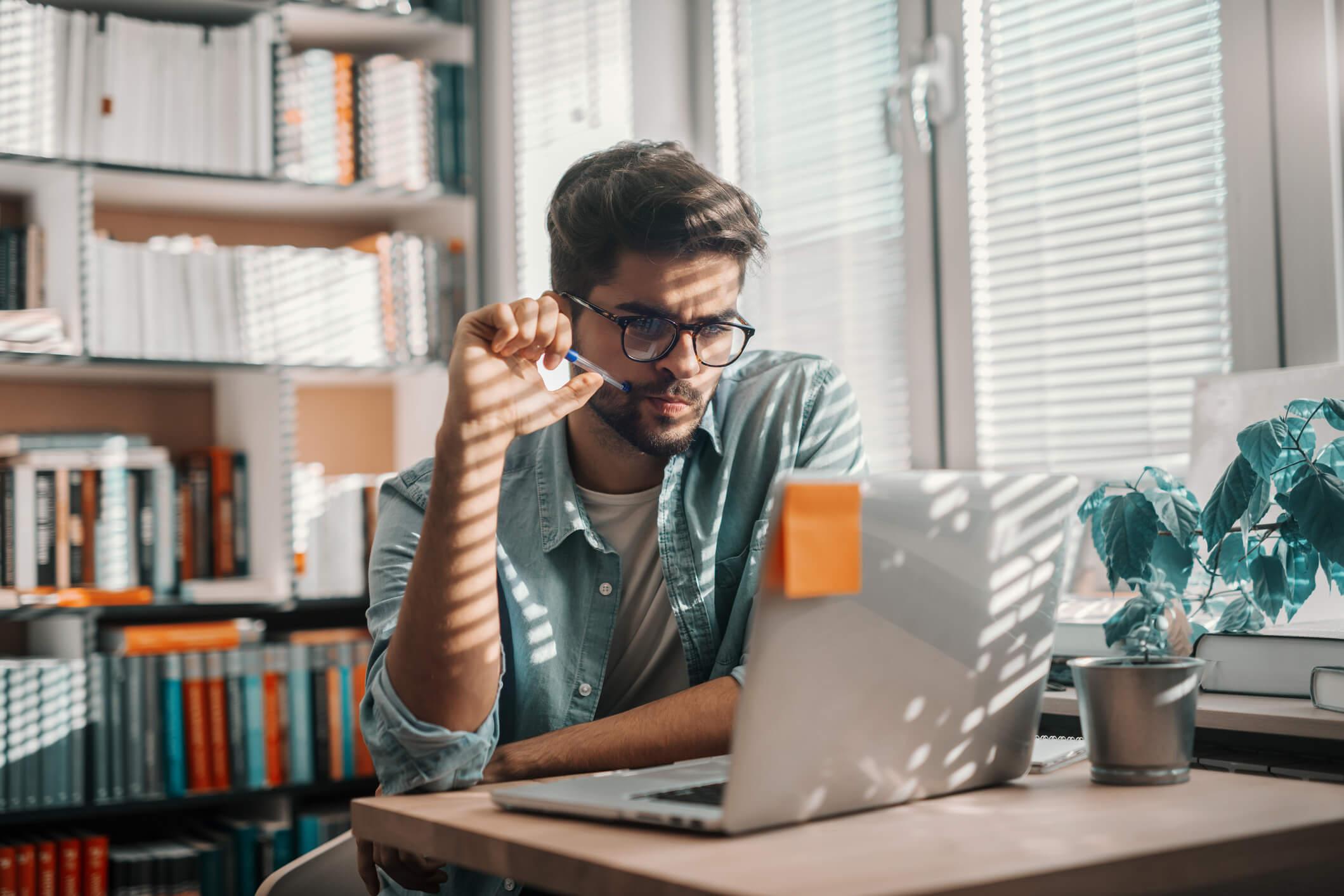 Man on laptop using Windscribe VPN