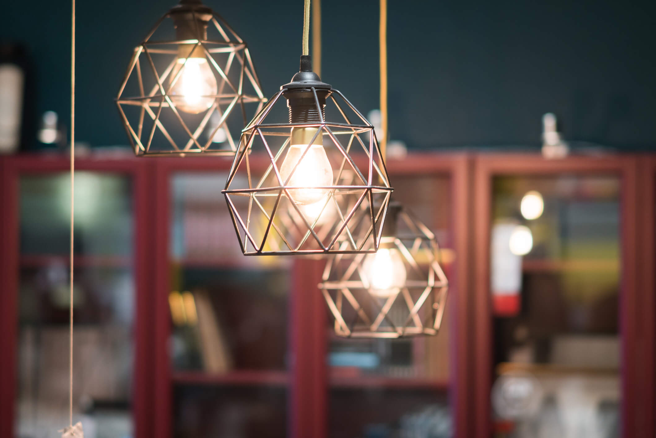 Three cage-style hanging lamps