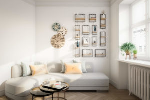 Living room with light-colored couch and walls and a collage of framed photos
