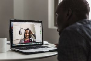 Man and woman having a video chat