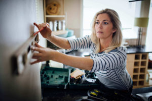 Woman prepping for DIY home security