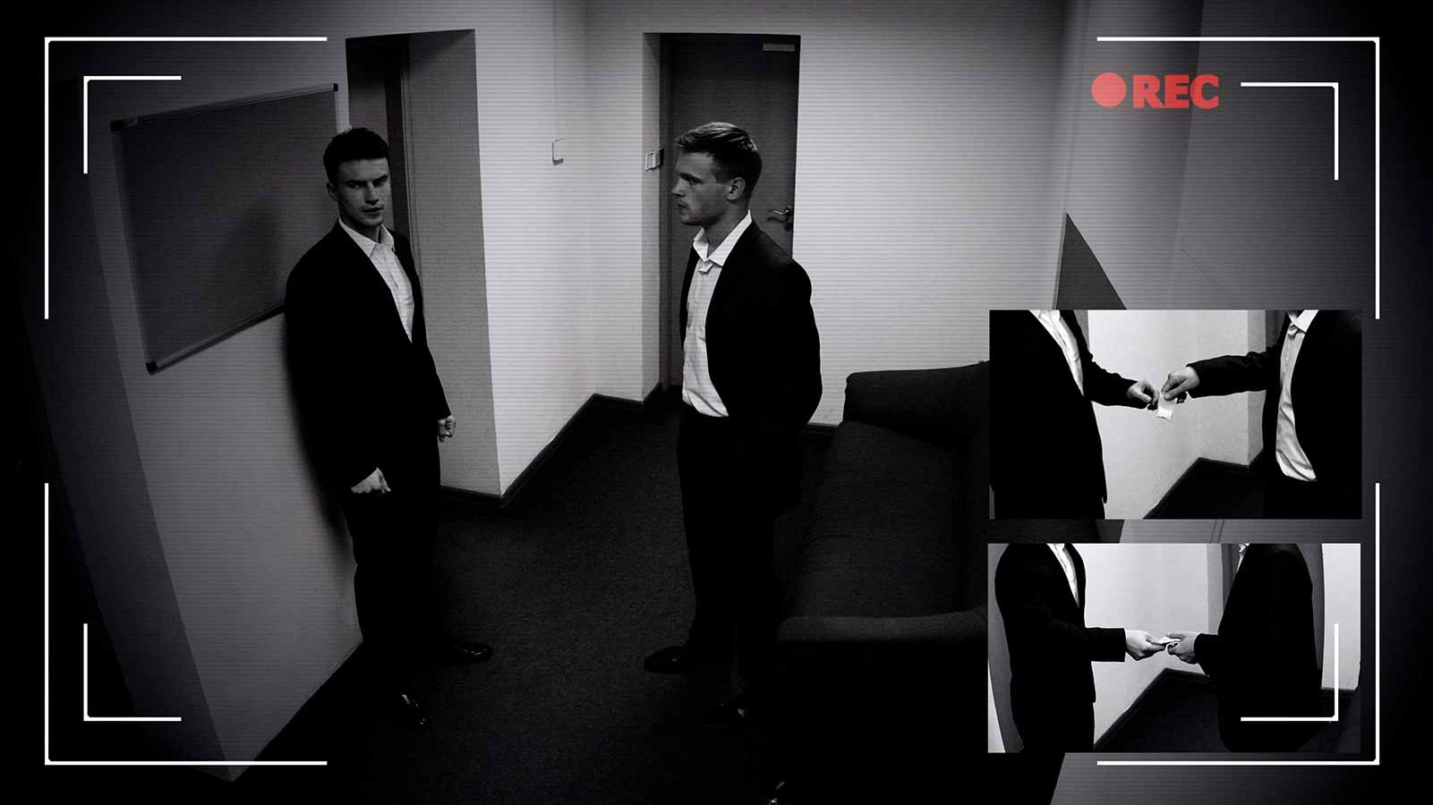 two men making a deal on a security camera
