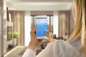 Woman setting up smart home with app
