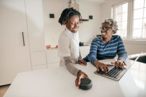 Young and old woman setting up Echo Dot