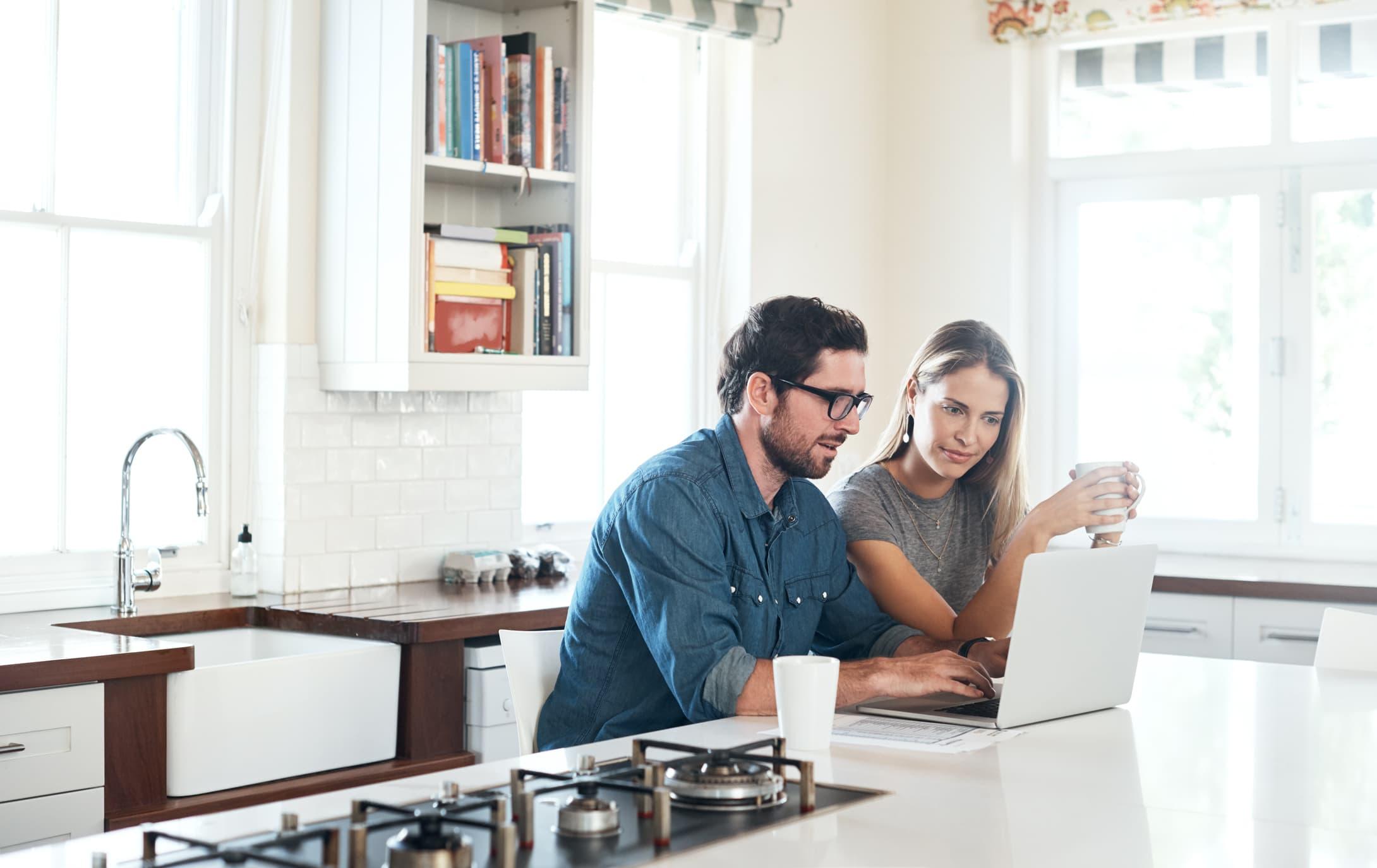 Couple on laptop together ExpressVPN vs IPVanish