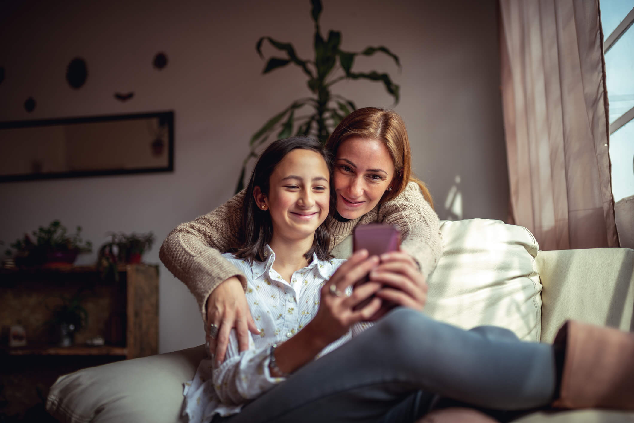 Mom and Daughter Using a Phone