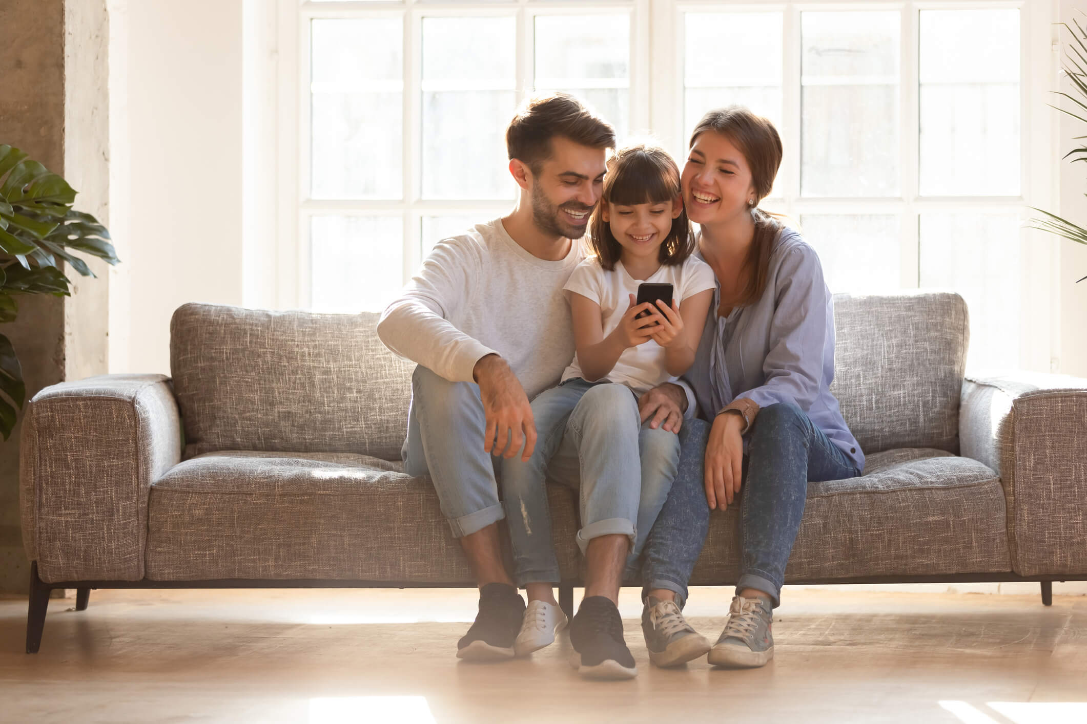 Family Using a Cell Phone