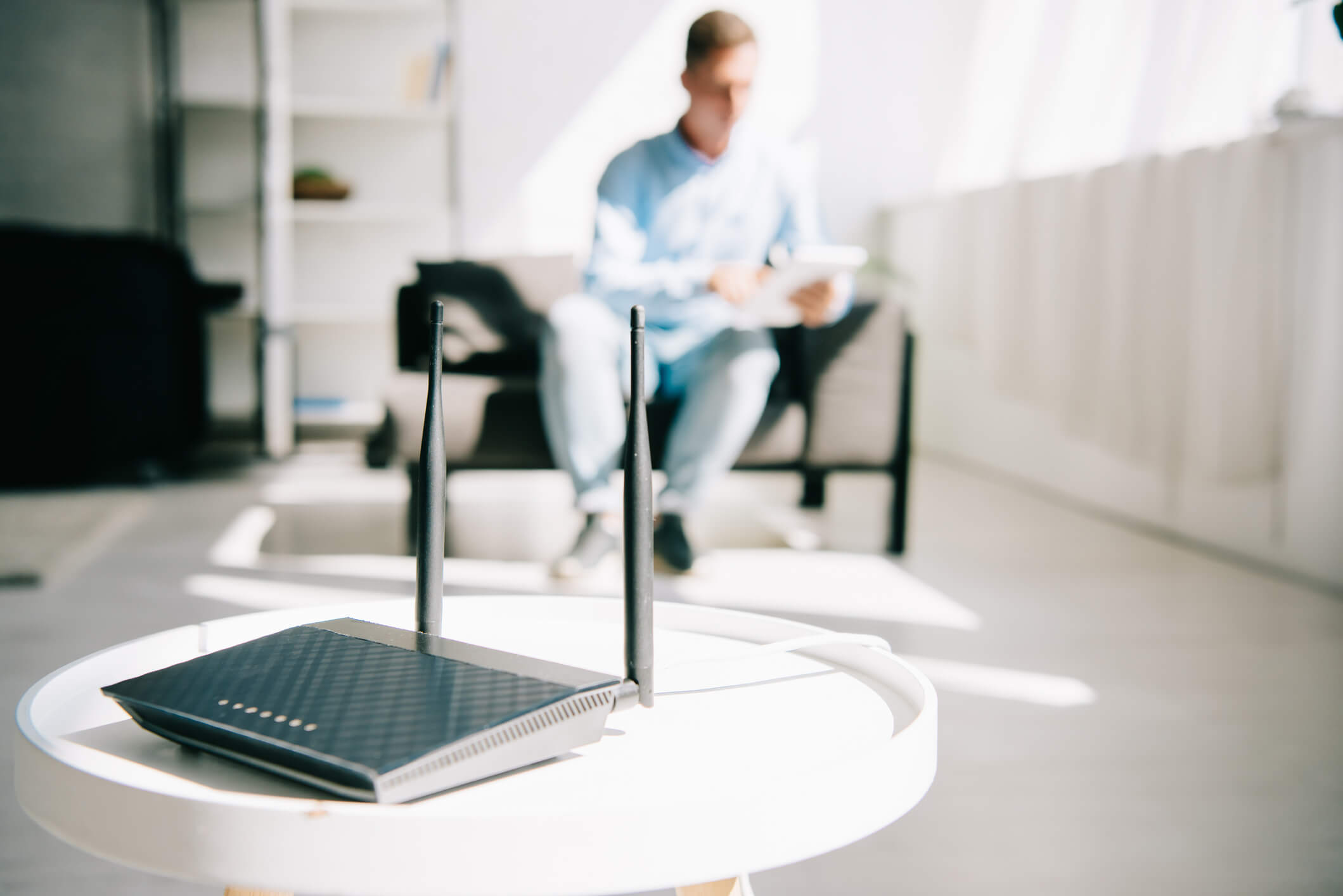 Router with VPN on table with person in the background