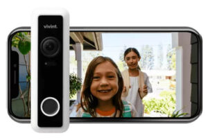 Vivint Doorbell Camera Pro in front of a cellphone showing a live view from the camera featuring a little girl and a woman.