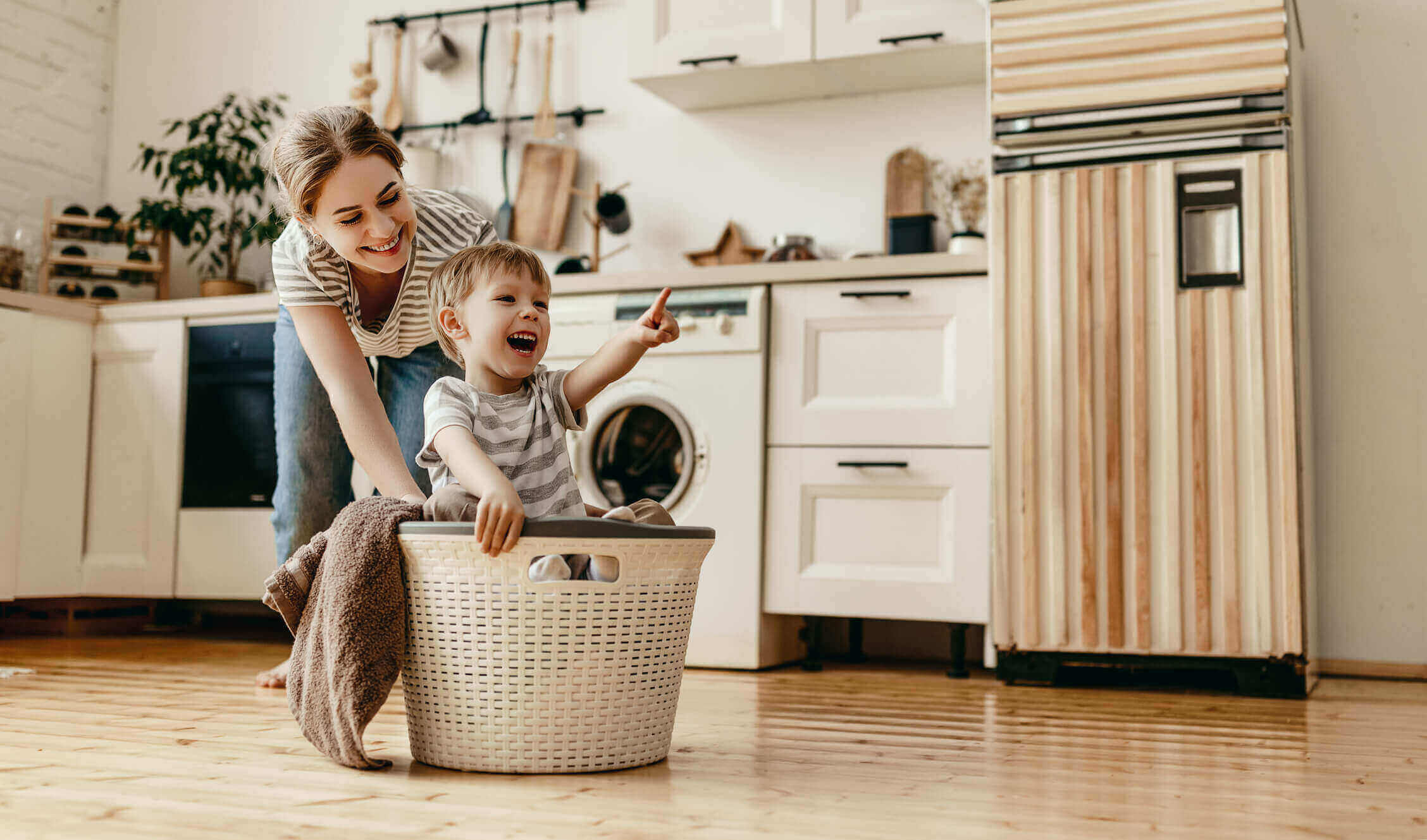 Mom and kid in laundry basket