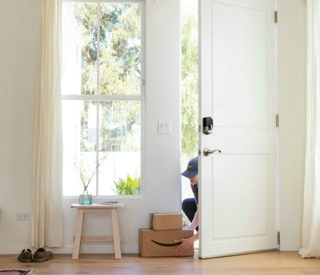 Delivery person setting packages inside a front door