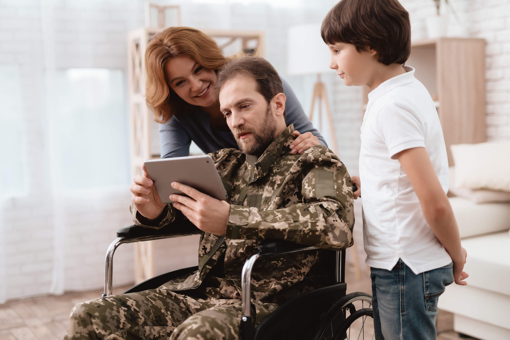 Veteran and family using tablet