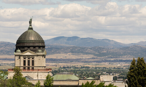The capitol building in Helena, Montana, with plains and rolling hills in the background