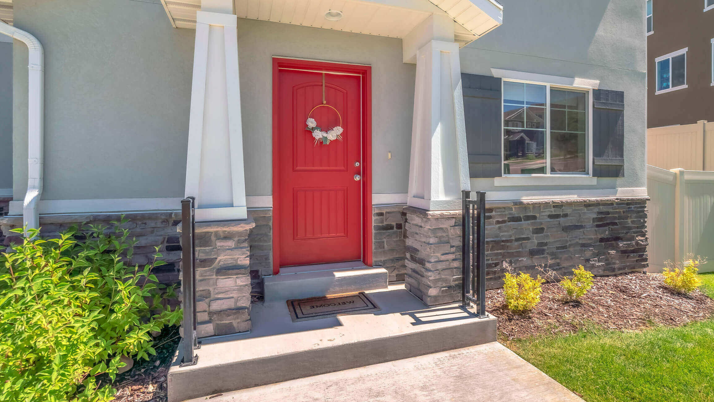 Exterior of a home with a red door