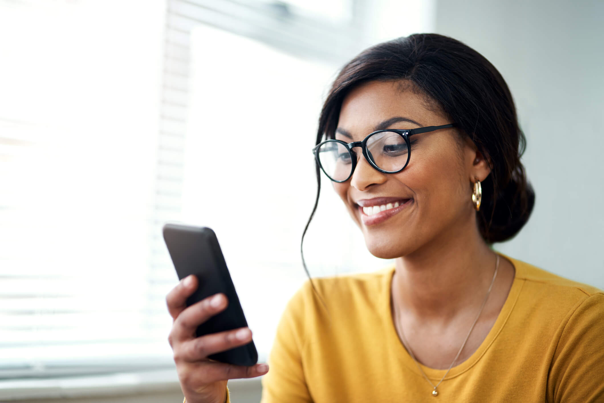 Woman Using a Phone with Glasses