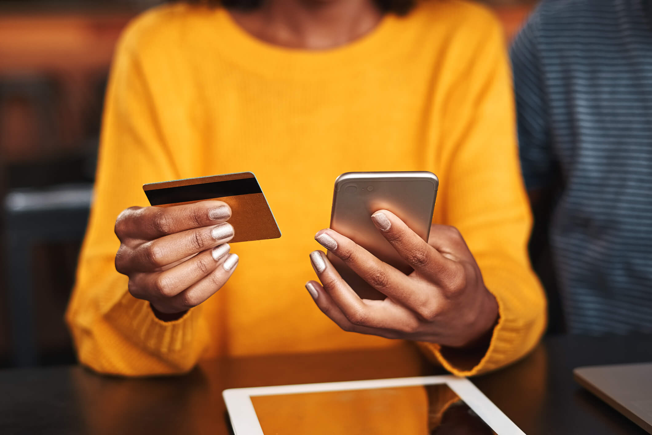 Woman looking at app with credit card
