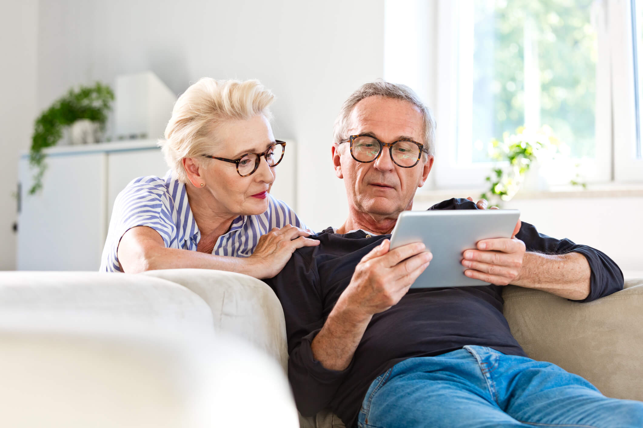 Older adults viewing camera feed on tablet