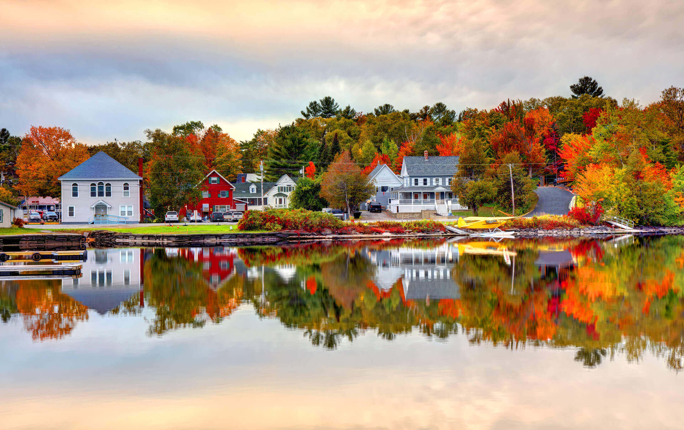 Homes on the edge of a lake in fall